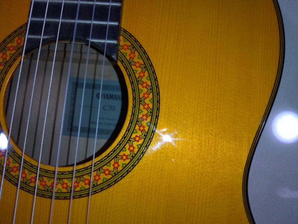 Name:  yamaha_c70_acoustic_guitar_1547006816_73d8c1cb.jpg Views: 160 Size:  92.8 KB