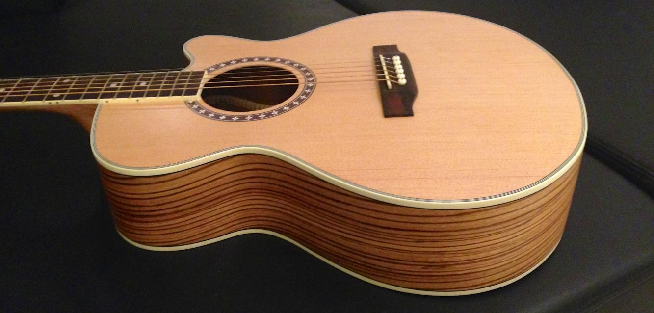 Name:  JG53A Spruce Top Zebrawood Sides Under Studio Lighting.jpg