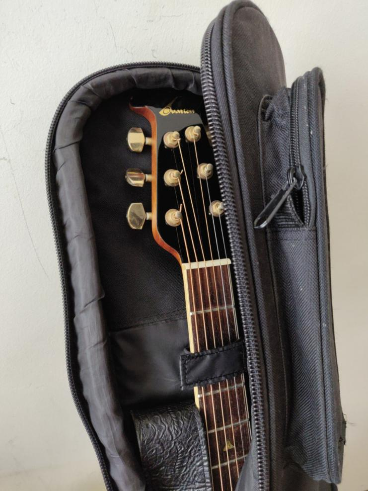 Name:  99_ovation_acoustic_guitar_made_in_korea_with_case_1545555584_4d5566a8.jpg Views: 142 Size:  92.8 KB