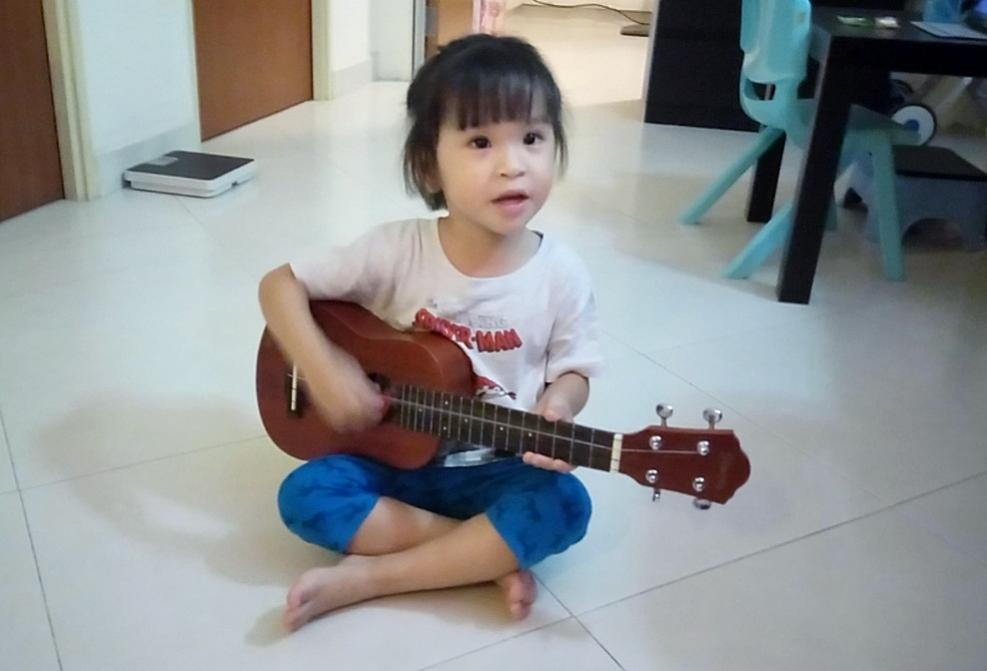Name:  Playing Ukulele.jpg