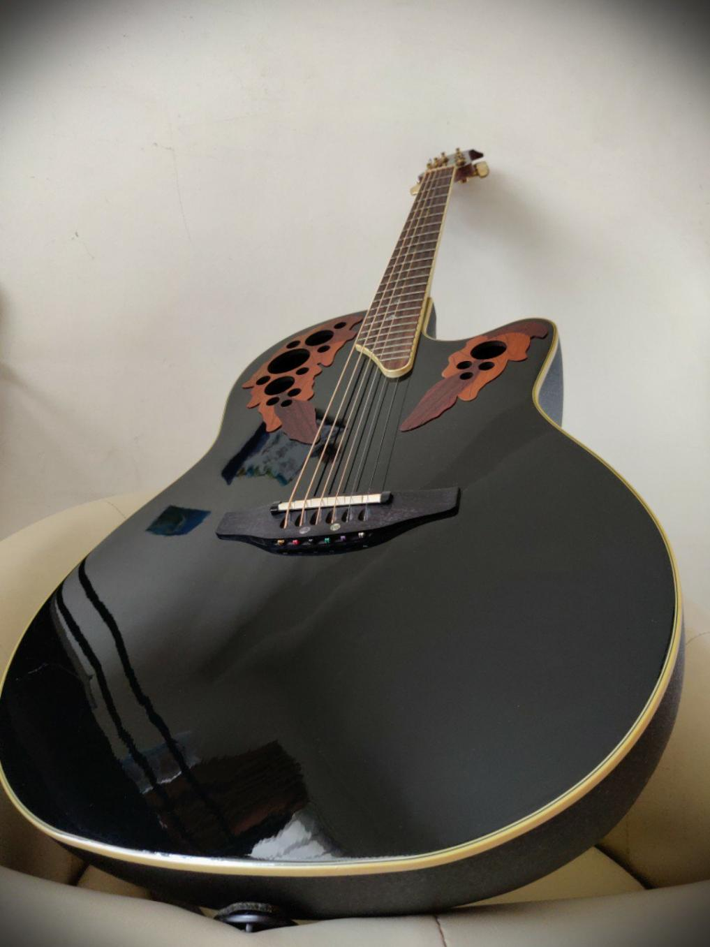 Name:  1_ovation_acoustic_guitar_made_in_korea_with_case_1545555737_6bb26832.jpg