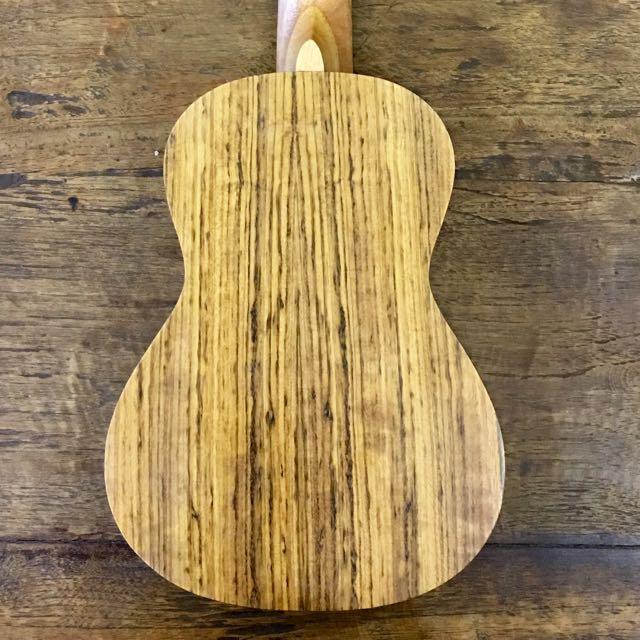 Name:  brand_new_exquisite_solid_top_ukulele_UK424 Back.jpg Views: 1004 Size:  76.9 KB